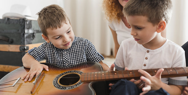 Improve Eye-hand Coordination Through Guitar Lessons for Kids